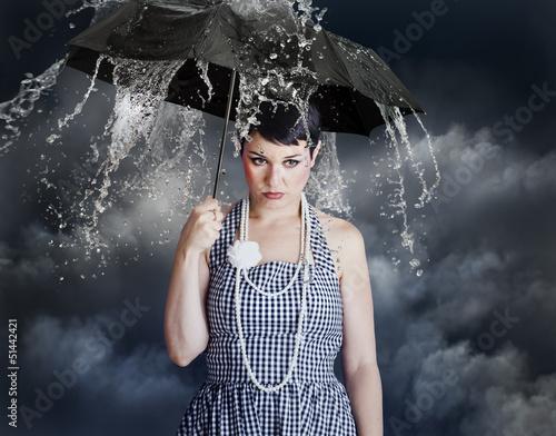 Acrylic Prints woman with black umbrella in heavy rain