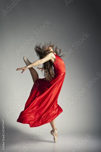 Tableau sur Toile Ballet dancer wearing red dress over grey