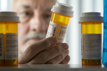 Man Reaching For Prescription ...
