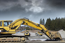 Giant Bulldozers In Action, Dark Clouds Moving In