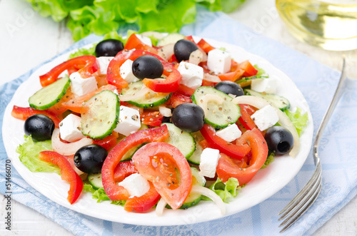 Fotografie, Obraz  Greek salad with feta cheese, olives and vegetables, horizontal