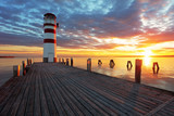 Lighthouse at Lake Neusiedl at sunset - 51476477
