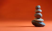 Zen Stones Stacked On Orange Background.