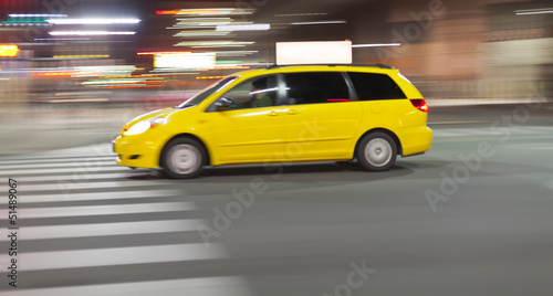 Staande foto New York TAXI Speeding Taxi cab at night in city