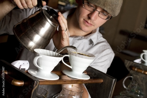 Fotografie, Obraz  a coffee house employee brew a single cup of coffee