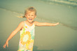 Adorable happy smiling girl on beach vacation