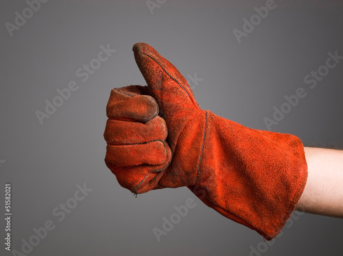 Hand expressing positivity with welder glove Canvas-taulu