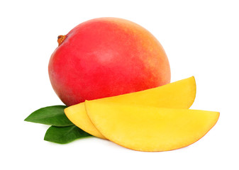 One whole mango and slices with green leaves (isolated)