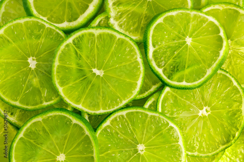 Fotografie, Obraz  Green background with  lime slices