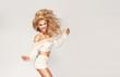 Leinwanddruck Bild - Dancing happy blonde woman looking at camera.