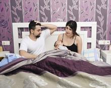Novice Parents And Baby Newborn In Vi.ntage Bedroom