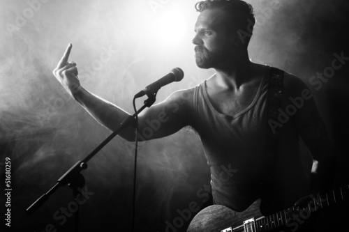 Fotografie, Obraz  Rocker with Attitude Gives Finger