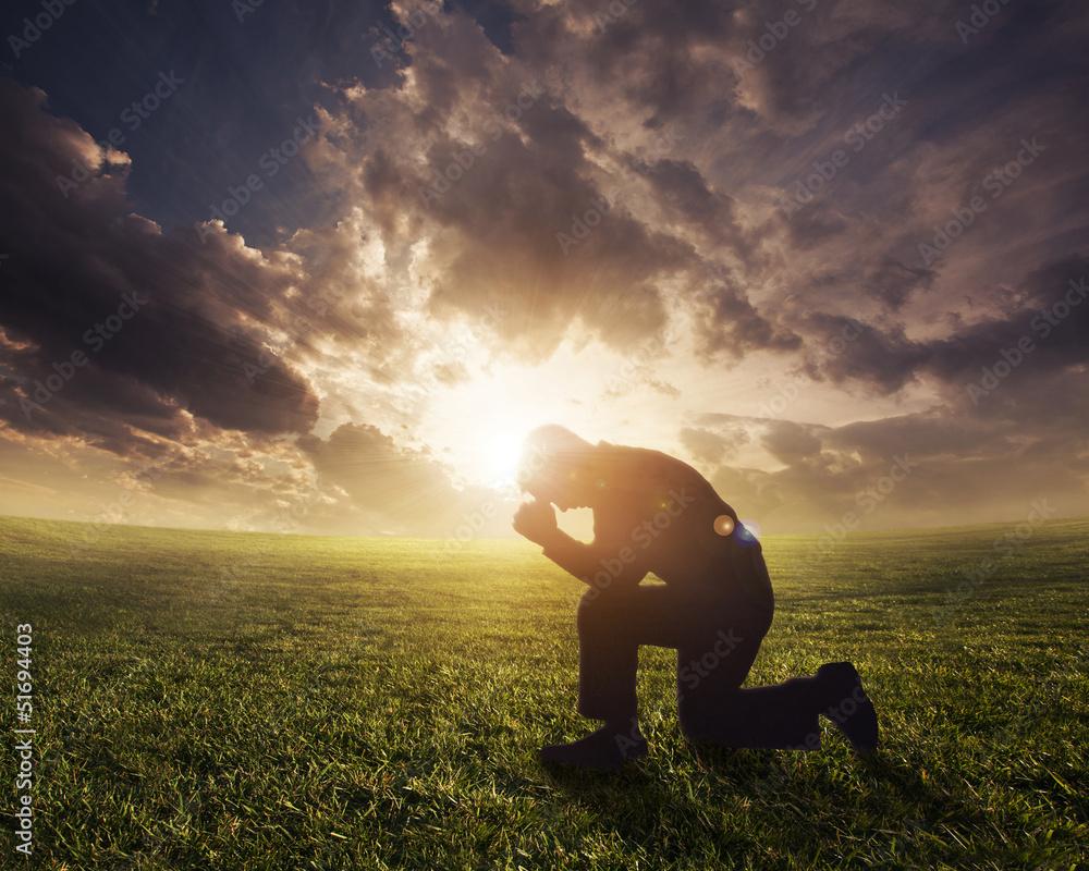 Fototapety, obrazy: Praying at sunset