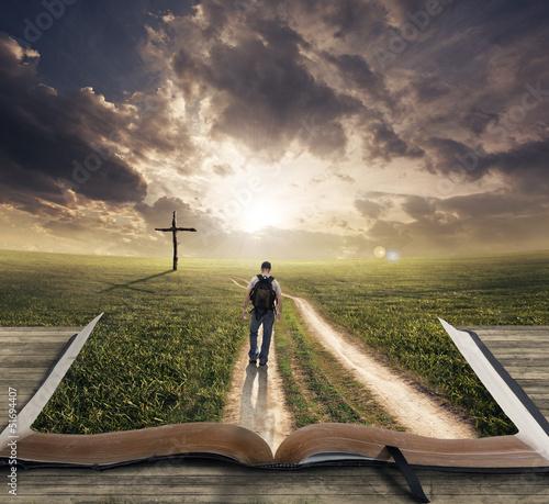 Obraz na plátně Man walking on Bible