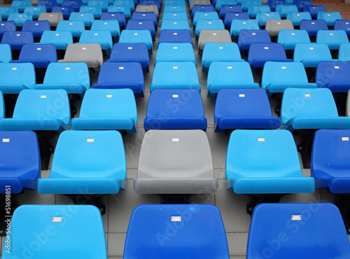 Fotobehang Stadion blue seats at stadium