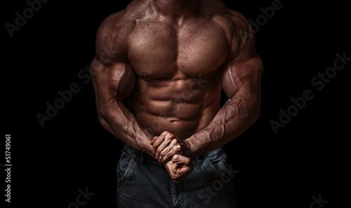 Fotografie, Obraz  Bodybuilder isolated on black background