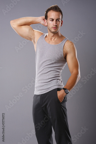 e5b7e5aaacfee Athletic young man in tank top - Buy this stock photo and explore ...