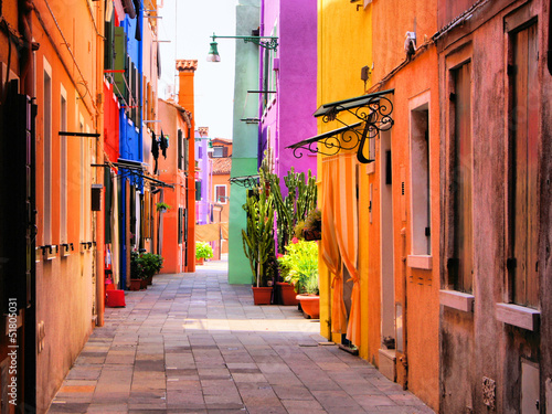 Photo Stands Narrow alley Colorful street in Burano, near Venice, Italy