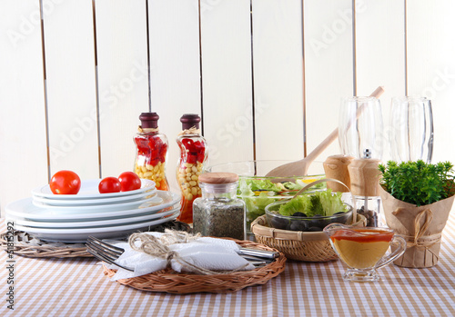 Photo Stands Herbs 2 Table setting on checkered tablecloth on wooden background