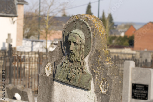 Effigie du Christ sur une tombe Fotobehang