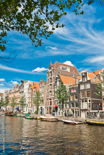 Photo  Amsterdam canals and typical houses