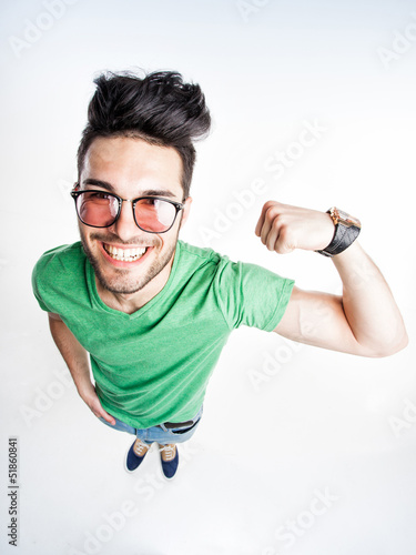 Fotografie, Obraz  funny handsome man with hipster glasses showing muscles