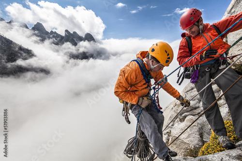 Fotografie, Obraz  Climbing team rappelling.