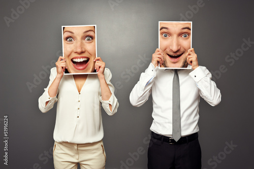 Poster  man and woman holding amazed happy faces