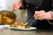 canvas print picture - Chef in hotel or restaurant kitchen cooking