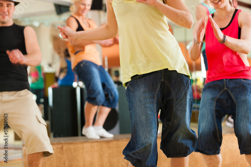 Fototapety, obrazy: Zumba or Jazzdance - young people dancing in studio