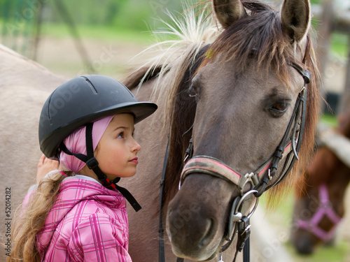 Poster Equitation Horse and lovely equestrian girl