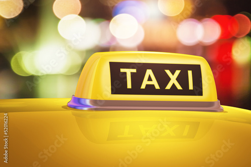 Fotografie, Obraz  Yellow taxi sign on car