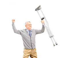 A Happy Gentleman Patient Holding Crutches And Gesturing Happine