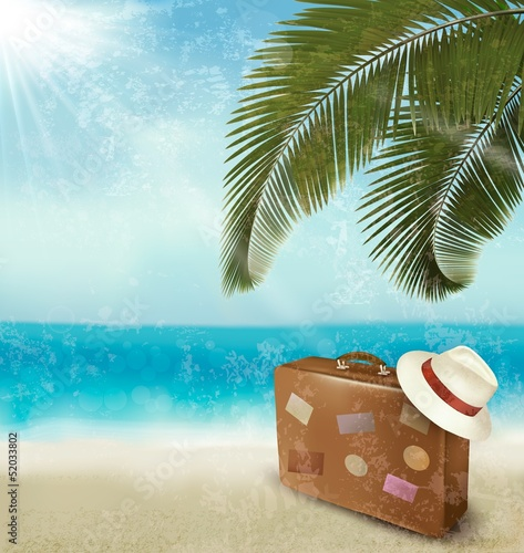 Fototapeta Vintage beautiful seaside background with suitcase and a hat. Ve