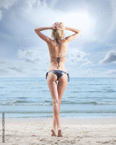 Young, beautiful, sporty and sexy blond woman on the beach Poster