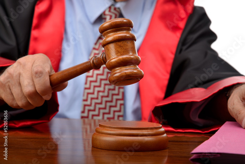 Fotografering  Judge striking the gavel to keep silence