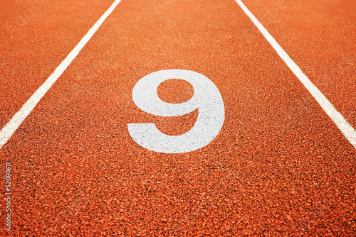 number nine on running track