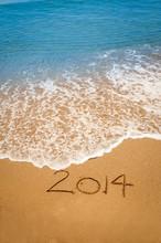 Year 2014 Written In Sand On T...