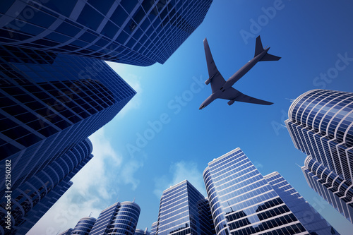 Poster Aan het plafond Business towers with a airplane silhouette