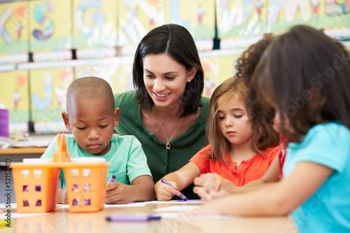 Fotografie, Obraz  Group Of Elementary Age Children In Art Class With Teacher