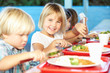 canvas print picture - Elementary Pupils Enjoying Healthy Lunch In Cafeteria