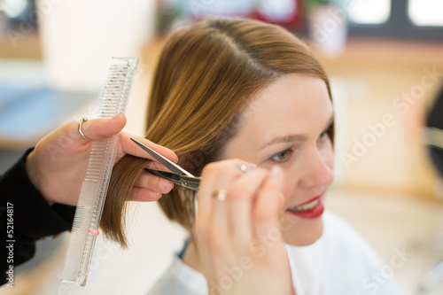 Closeup of hairdresser cutting hair