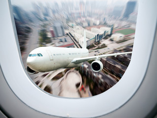 Fototapeta airplane away from the city