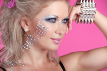 Beautiful Woman With Hair Styling And Evening Make-up. Jewelry A