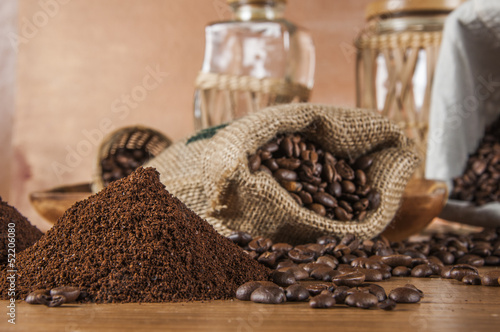 Deurstickers koffiebar Coffee beans, wooden table with ambient light