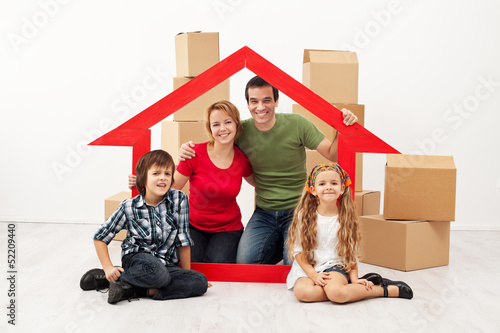 Fotografiet  Happy family with kids moving into a new home