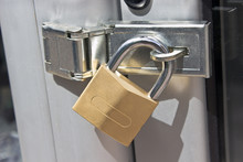 Closed Padlock On  A Metal Door