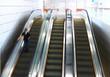 Blurred person on escalator