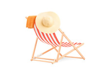 Towel And Hat On A Sun Lounger With Stripes