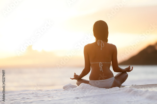 Obraz w ramie Meditation - Yoga woman meditating at beach sunset